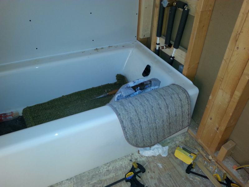 Installing Kohler cast iron tub (alcove) on plywood floor | Terry ...