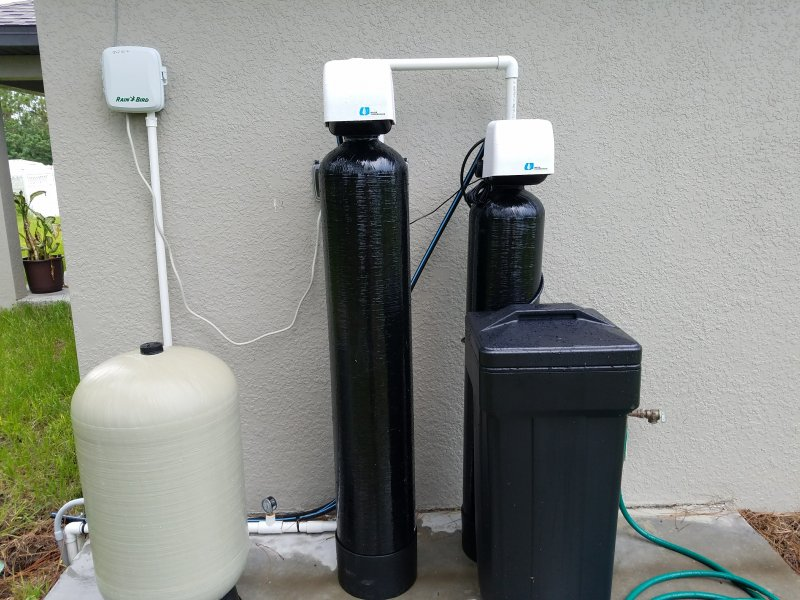 New home with new water softener system - water smells and leaves ...