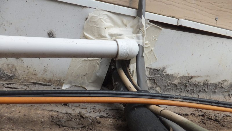Hole in exterior wall where HVAC condensation line comes in