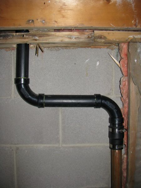 and here you can see below the sink the pipe coming from the drain goes up to an air admittance valve well above the drain height - Kitchen Sink Backed Up