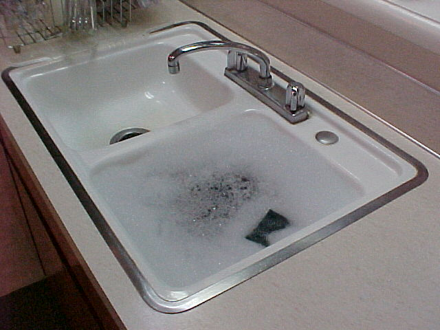 trouble removing metal rimmed kitchen sink | Terry Love Plumbing ...