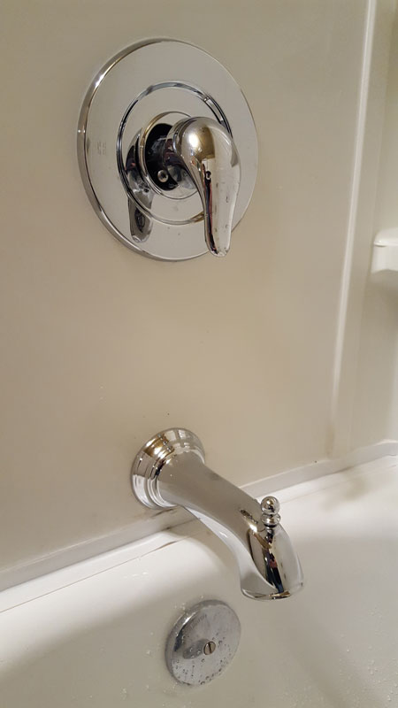 shower head that attaches to bathtub faucet.  IMG Installing shower head far from valve Terry Love Plumbing