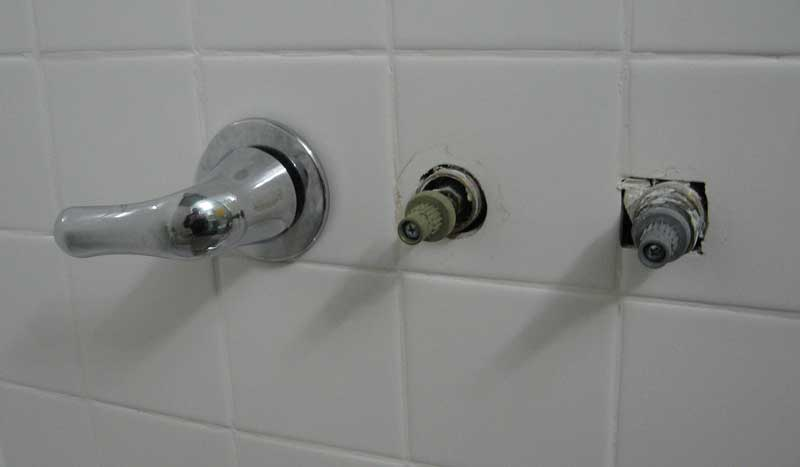 three handle tub and shower faucet.  IMG Replacing a three handle tub shower faucet with Moen Posi Temp